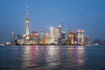 Pearl Tower over Pudong district skyline and Huangpu River S... by Danita Delimont