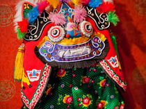 Chinese Colorful Souvenir Puppet Dragon Beijing, China von Danita Delimont