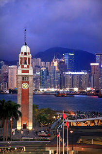 Hong Kong Clock Tower and Harbor at Night from Kowloon Ferry by Danita Delimont
