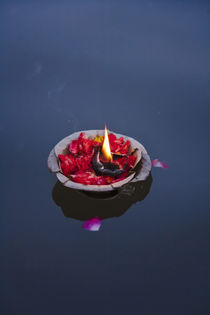 Flower lamp on the Ganges River, Varanasi, India by Danita Delimont