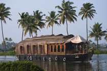 Houseboat on the backwaters of Kerala, India by Danita Delimont