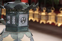 Smaller metal and gold lanterns are representations of their... von Danita Delimont