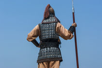 Backside of traditional dressed guard at Gongsanseong Castle... von Danita Delimont