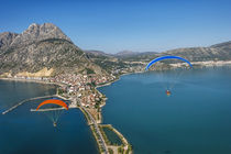 Aerial view of Yesilada in Lake Egirdir, paramotors flying, ... by Danita Delimont