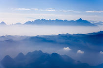 Aerial view of mountain layers. by Danita Delimont