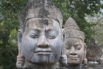 Buddhist statues at the South Gate of Angkor Thom, Cambodia,... by Danita Delimont