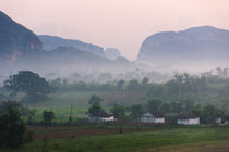 Limestone hill, farming land and village house in morning mi... by Danita Delimont