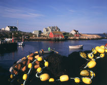 Canada, Nova Scotia, Peggy's Cove, Fishing nets and houses at harbor by Danita Delimont