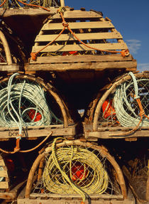 Canada, Nova Scotia, Cape Breton, Stack of lobster traps at ... by Danita Delimont