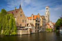 Belfry of Bruges towers over the buildings at the junction o... by Danita Delimont