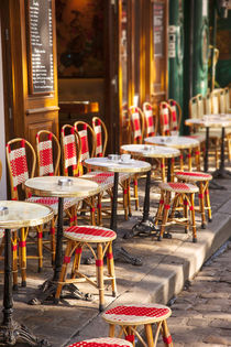 Cafe tables and chairs waiting for customers in Place du Ter... by Danita Delimont