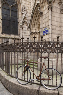 Bicycle chained to fence at Eglise Saint Severin in the Lati... by Danita Delimont