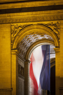 Flag flies inside the Arc de Triomphe, Paris, France. by Danita Delimont