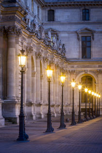 Row of lamps in the courtyard of Musee du Louvre, Paris, France. by Danita Delimont