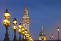 Row of lampposts along Pont Alexandre III with dome of Hotel... by Danita Delimont