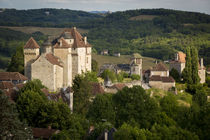Evening sunlight over medieval town of Curemont, in the anci... von Danita Delimont