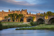 Setting sunlight over town of Carcassonne and River Aude, La... by Danita Delimont