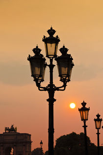 Lamp posts at sunset, Louvre Museum, Paris, France by Danita Delimont