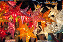 Hanging paper cutout star lamps, Christmas market, Heidelberg, Germany by Danita Delimont