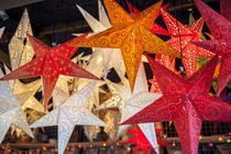Hanging paper cutout star lamps, Christmas market, Mainz, Germany by Danita Delimont