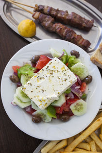 Greece, Peloponnese, Corinth, Greek Salad and Souvlaki with ... von Danita Delimont