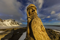 Wood carving of an ancient Viking at Vestrahorn, Mountain ne... by Danita Delimont