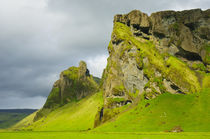Near Skogafoss. Outcropping of volcanic rock dwarfs a farmhouse below. by Danita Delimont