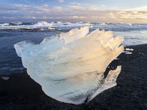 Iceberg on black volcanic beach by Danita Delimont