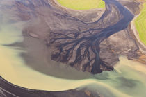 Aerial view of river estuary or delta, coloured by glacial melt, by Danita Delimont