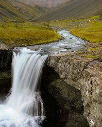 Water running from Glacier and waterfall, Iceland by Danita Delimont