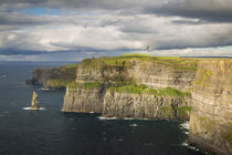 Setting sunlight over Cliffs of Moher, County Clare, Republi... by Danita Delimont