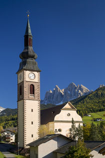 Autumn view of Sant Jakob Church with the Dolomites beyond, ... by Danita Delimont