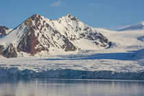 Svalbard. Hornsund. Mountains surrounding the still water of... by Danita Delimont