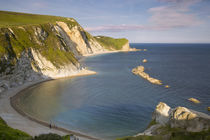 Evening overlooking Man O War Bay along the Jurassic Coast, ... von Danita Delimont