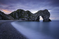 Colorful sky at dawn over Durdle Door along the Jurassic Coa... by Danita Delimont