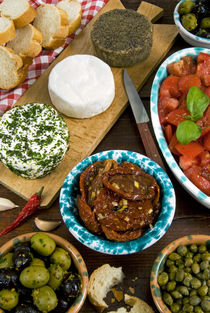Maltese appetizer Gbejniet with capers, fresh tomatoes, drie... by Danita Delimont