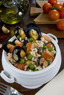 Seafood rice with mussels, shrimps, tomato, olives, peas, It... by Danita Delimont