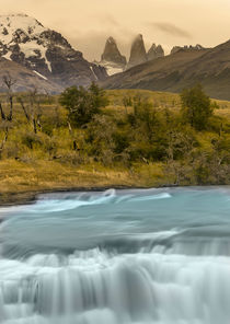 River and waterfall with Las Torres in background by Danita Delimont