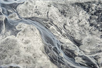 Rivulets of glacial melt water form this abstract by Danita Delimont