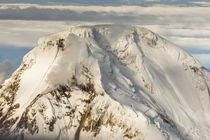 Aerial view Iliamna volcano rising up in Aleutian mountain r... by Danita Delimont