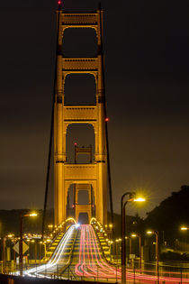 Early morning traffic on the Golden Gate Bridge in San Franc... by Danita Delimont