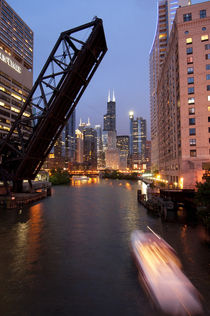 Chicago River and skyline at dusk with boat by Danita Delimont