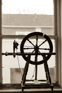 Spinning wheel in a window, Wilmington, Illinois, USA by Danita Delimont