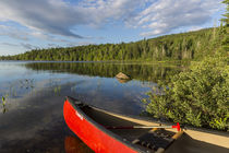 A canoe on the shore of Bald Mountain Pond by Danita Delimont