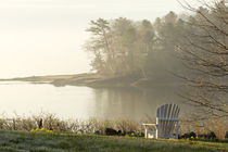 Foggy morning in spring, chair overlooking Casco Bay, Freeport, Maine von Danita Delimont