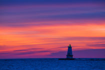 Ludington North Pierhead Lighthouse at sunset on Lake Michig... by Danita Delimont