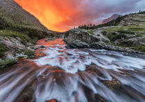 Brilliant sunrise sky over Swiftcurrent Falls in Glacier Nat... by Danita Delimont