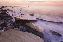 Pre-dawn light and waves wash over the rocks at Rye Harbor S... by Danita Delimont