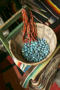 Basket containing round turquoise beads, Santa Fe, New Mexico, USA. by Danita Delimont