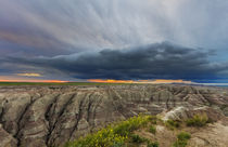 Dramatic storm cloud at sunrise in Badlands National Park, S... by Danita Delimont